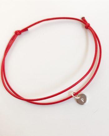 minicoin med röd snodd